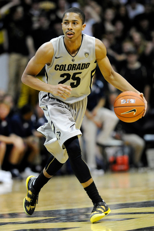 . BOULDER, CO. - FEBRUARY 14: Colorado Buffaloes guard Spencer Dinwiddie (25) brought the ball down court in the second half. The University of Colorado men\'s basketball team defeated Arizona 71-58 Thursday night, February 14, 2013 at the Coors Event Center in Boulder. (Photo By Karl Gehring/The Denver Post)