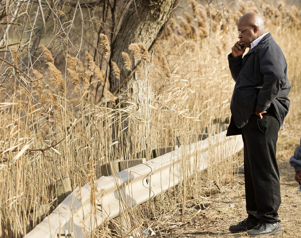. Derrick Ray, the father of Daylan Ray, talks on his phone at the crash site that claimed the life of his son and five others on Park Ave. in Warren, Ohio on Sunday, March 10, 2013. (AP Photo/Scott R. Galvin)