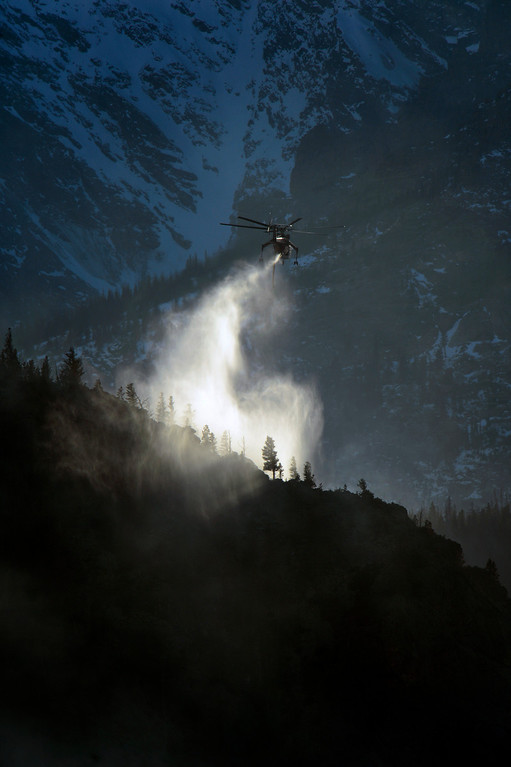 . Helitankers fight the Fern Lake fire, smoldering at Historic Moraine Park in the  Rocky Mountain National Park, in Colorado Monday, December 3,  2012.    Joe Amon, The Denver Post