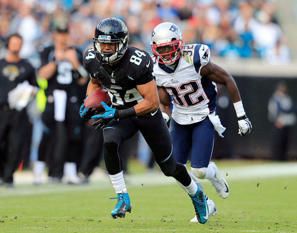 . Cecil Shorts #84 of the Jacksonville Jaguars attempts to run past  Devin McCourty #32 of the New England Patriots during the game at EverBank Field on December 23, 2012 in Jacksonville, Florida.  (Photo by Sam Greenwood/Getty Images)