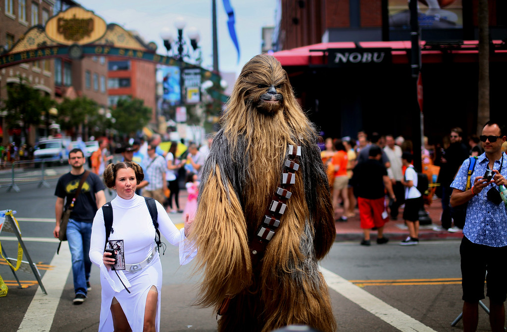 . SAN DIEGO, CA - JULY 19: Star Wars characters walk down 5th Avenue during Comic Con on July 19, 2013 in San Diego, California.  Comic Con International Convention is the world\'s largest comic and entertainment event and hosts celebrity movie panels, a trade floor with comic book, science fiction and action film-related booths, as well as artist workshops and movie premieres. (Photo by Sandy Huffaker/Getty Images)
