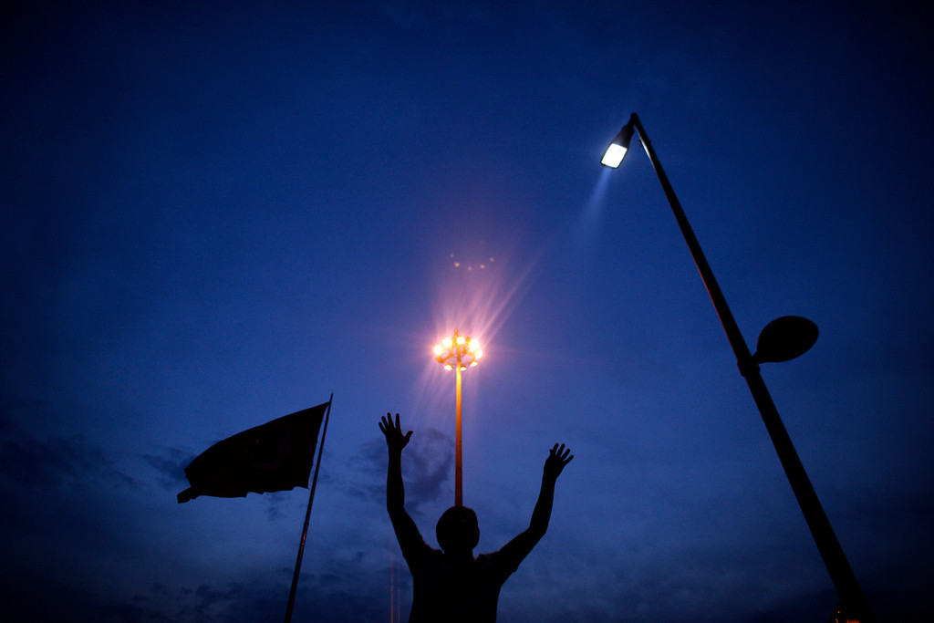 . A protester raises his hands during a protest  at Taksim square in Istanbul, Tuesday, June 4, 2013. (AP Photo/Kostas Tsironis)