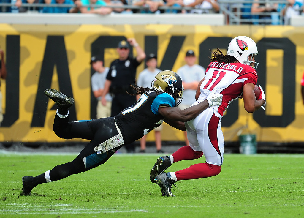 . Larry Fitzgerald #11 of the Arizona Cardinals runs with a catch against Johnathan Cyprien #37 of the Jacksonville Jaguars at EverBank Field on November 17, 2013 in Jacksonville, Florida. (Photo by Scott Cunningham/Getty Images)