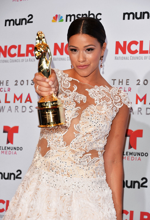 . PASADENA, CA - SEPTEMBER 27:  Actress Gina Rodriguez (posing with the Special Achievement in Film award for \'Filly Brown\') attends the Winner\'s Walk during the 2013 NCLR ALMA Awards at Pasadena Civic Auditorium on September 27, 2013 in Pasadena, California.  (Photo by Alberto E. Rodriguez/Getty Images for NCLR)