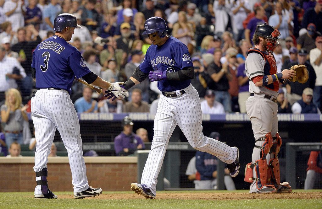 . DENVER, CO. - SEPTEMBER 24: Troy Tulowitzki (2) of the Colorado Rockies is congratulated by Michael Cuddyer (3) of the Colorado Rockies after hitting a home run in the third inning agains the Boston Red Sox September 24, 2013 at Coors Field. (Photo by John Leyba/The Denver Post)