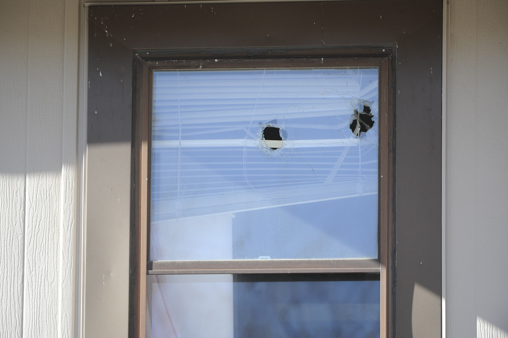 . Bullet holes in the second story window at 16005c Ithaca, a murder scene, in Aurora Saturday morning. Four poeple were killed including the shooter. Andy Cross, The Denver Post
