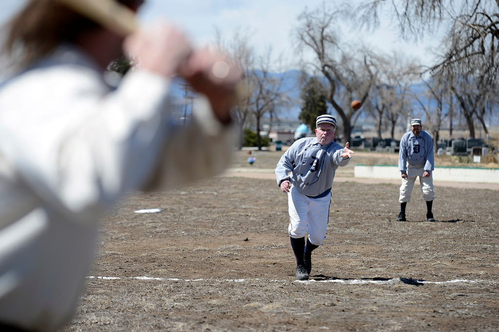 . DENVER, CO. - APRIL 14: Andy Red Regan of the  Denver Blue Stockings delivers a pitch during their vintage baseball game against the Central City Stars April 14, 2013 at  Riverside Cemetery in Denver. (Photo By John Leyba/The Denver Post)