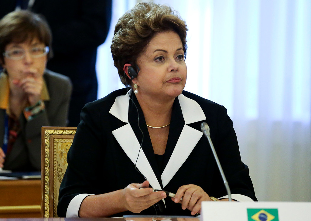. Brazil\'s President Dilma Rousseff listens during a round table meeting at the G-20 summit in St. Petersburg, Russia on Thursday, Sept. 5, 2013.  (AP Photo/Sergei Karpukhin, Pool)
