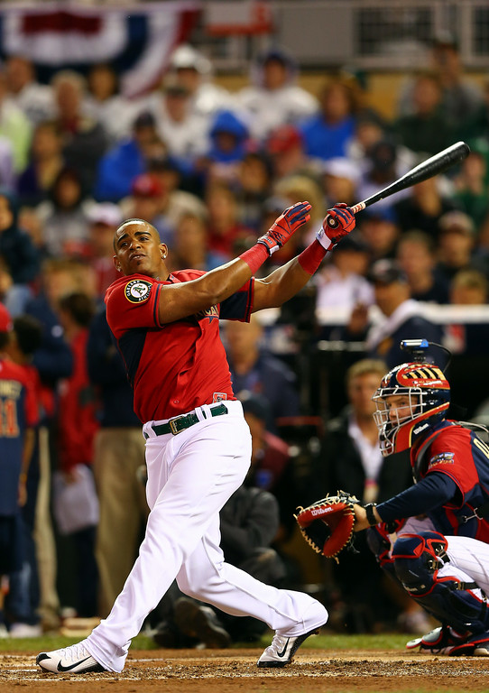 . American League All-Star Yoenis Cespedes #52 of the Oakland A\'s bats during the Gillette Home Run Derby at Target Field on July 14, 2014 in Minneapolis, Minnesota.  (Photo by Elsa/Getty Images)