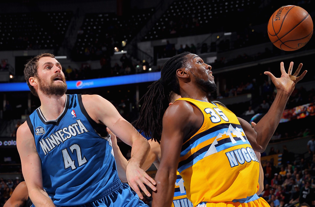 . DENVER, CO - NOVEMBER 15:  Kenneth Faried #35 of the Denver Nuggets grabs a rebound away from Kevin Love #42 of the Minnesota Timberwolves at Pepsi Center on November 15, 2013 in Denver, Colorado. (Photo by Doug Pensinger/Getty Images)
