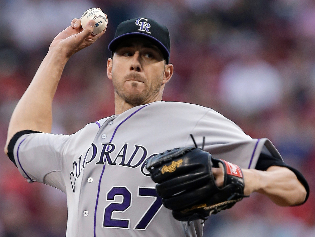 . Colorado Rockies starting pitcher Jon Garland throws against the Cincinnati Reds in the first inning of a baseball game, Wednesday, June 5, 2013, in Cincinnati. (AP Photo/Al Behrman)