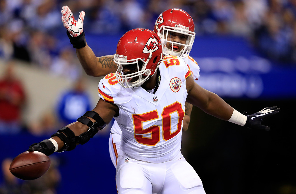 . INDIANAPOLIS, IN - JANUARY 04: Outside linebacker Justin Houston #50 of the Kansas City Chiefs celebrates against the Indianapolis Colts during a Wild Card Playoff game at Lucas Oil Stadium on January 4, 2014 in Indianapolis, Indiana.  (Photo by Rob Carr/Getty Images)