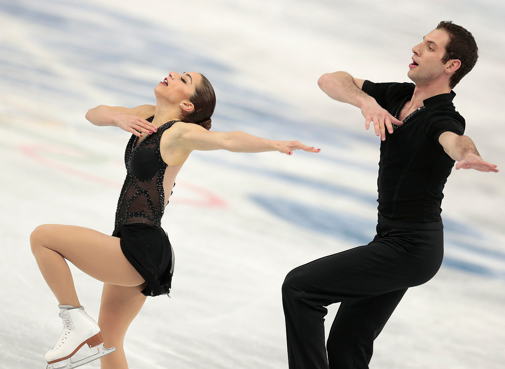 . Marissa Castelli and Simon Shnapir of the United States compete in the pairs short program figure skating competition at the Iceberg Skating Palace during the 2014 Winter Olympics, Tuesday, Feb. 11, 2014, in Sochi, Russia. (AP Photo/Ivan Sekretarev)
