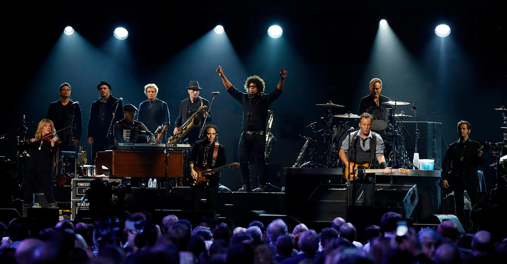 ". Saxophonist Jake Clemons (C), nephew of the late Clarence Clemons, performs with singer Bruce Springsteen (R) during the ""12-12-12\"" benefit concert for victims of Superstorm Sandy at Madison Square Garden in New York December 12, 2012. REUTERS/Lucas Jackson"