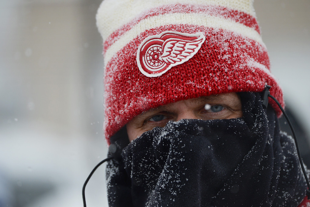 . A fan is prepared for the elements prior to the Detroit Red Wings playing the Toronto Maple Leafs before the 2014 Bridgestone NHL Winter Classic on January 1, 2014 at Michigan Stadium in Ann Arbor, Michigan.  (Photo by Jamie Sabau/Getty Images)