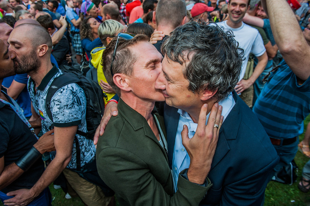 """. Antwerp alderman Ludo Vancampenhout (R) participates in a  \'Kiss-In\' action at the Russian consulate in Antwerp to protest against the treatment of lesbian, gay, bisexual and transgender oriented people in Russia on August 9, 2013.  Russia on Friday said it was unperturbed by threats of an Olympic boycott over a controversial law banning \""""homosexual propaganda\"""", despite wide-ranging criticism of the legislation from athletes to US President Barack Obama. JONAS ROOSENS/AFP/Getty Images"""