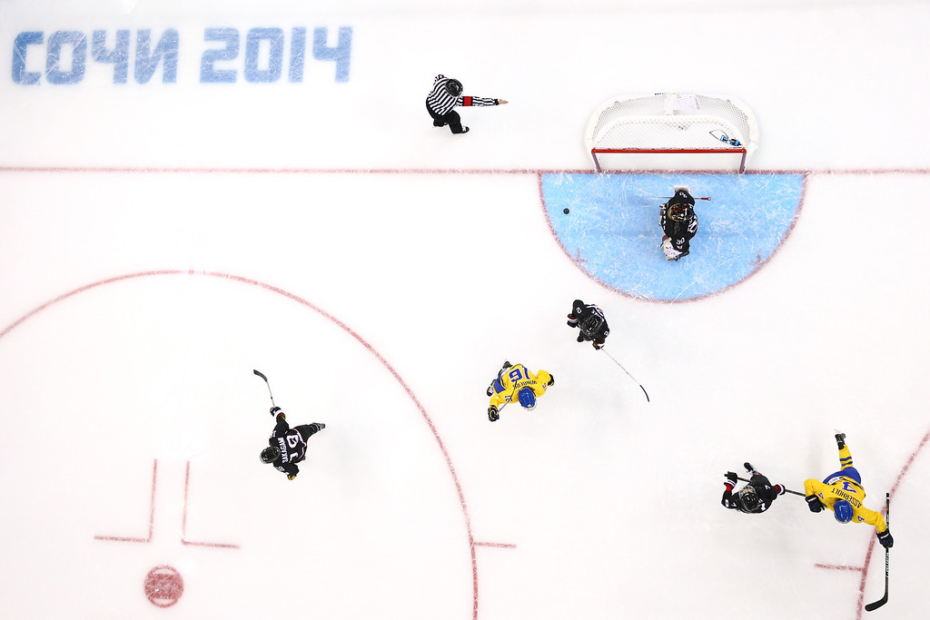 . SOCHI, RUSSIA - FEBRUARY 09:  Jenni Asserholt #4 of Sweden celebrates scoring the first goal during the Women\'s Ice Hockey Preliminary Round Group B Game on day two of the Sochi 2014 Winter Olympics at Shayba Arena on February 9, 2014 in Sochi, Russia.  (Photo by Martin Rose/Getty Images)