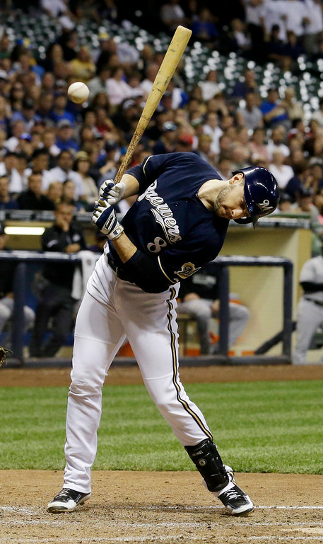 . Milwaukee Brewers\' Ryan Braun is hit by a pitch with the bases loaded during the seventh inning of a baseball game against the Colorado Rockies on Friday, June 27, 2014, in Milwaukee. (AP Photo/Morry Gash)