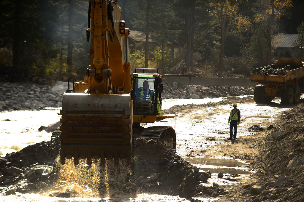 . An excavator pulls rock and dirt out of  the Big Thompson River to put it  into a dump truck near Drake, Co on October 16, 2013. They are trying to re-divert the river back to where it used to flow. (Photo By Helen H. Richardson/ The Denver Post)