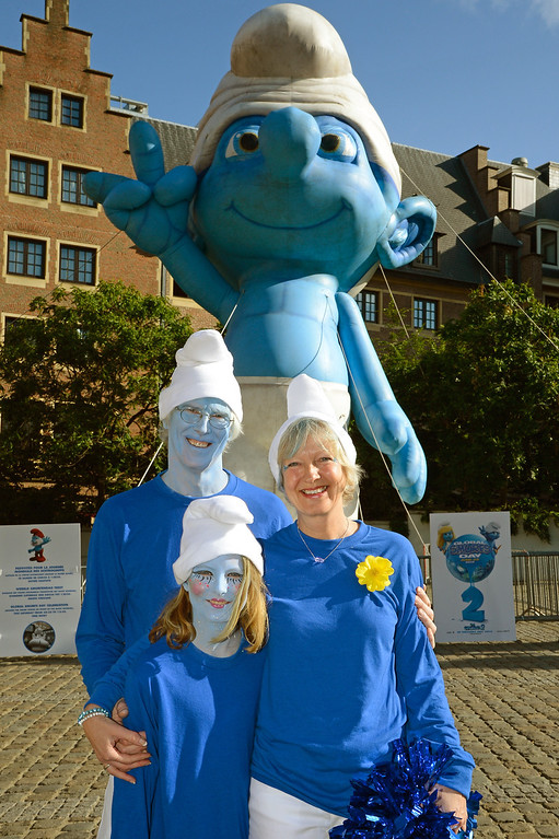 . L-R) Marc Guerin, Nina Guerin Culliford and Veronique Culliford, the daughter of cartoonist Peyo, the creator of The Smurfs, pose by a giant Smurf character during Global Smurfs Day celebrations on June 22, 2013 in Brussels, Belgium.  (Photo by Pascal Le Segretain/Getty Images for Sony Pictures Entertainment)