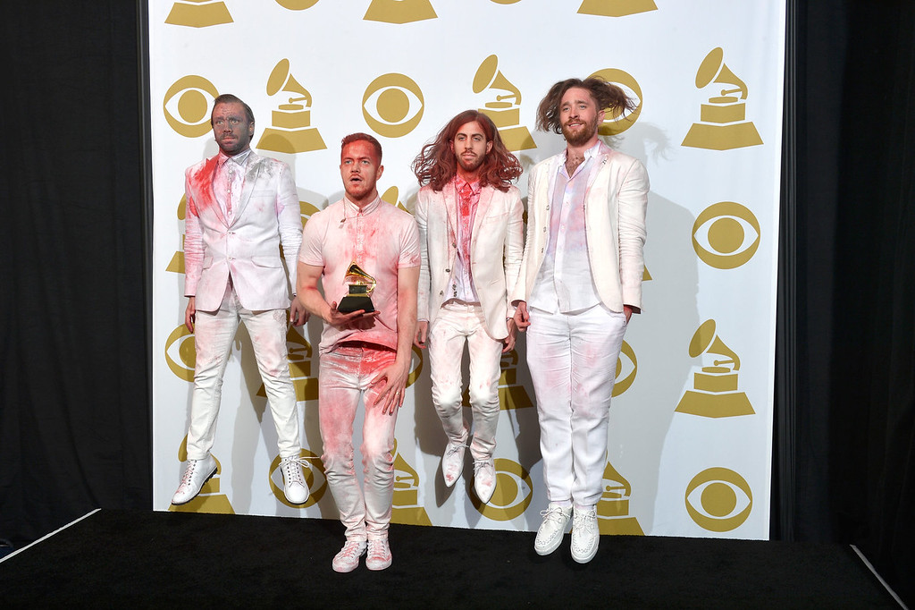 ". (L-R) Musicians Ben McKee, Dan Reynolds, Wayne Sermon, and Daniel Platzman of Imagine Dragons, winners of the Best Rock Performance Award for ""Radioactive\"" pose in the press room during the 56th GRAMMY Awards at Staples Center on January 26, 2014 in Los Angeles, California.  (Photo by Frazer Harrison/Getty Images)"