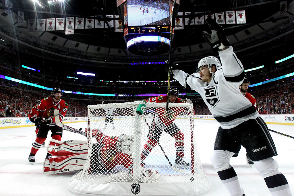 . Dustin Brown #23 of the Los Angeles Kings celebrates Marian Gaborik #12 goal against Corey Crawford #50 of the Chicago Blackhawks in the first period during Game Five of the Western Conference Final in the 2014 Stanley Cup Playoffs at United Center on May 28, 2014 in Chicago, Illinois.  (Photo by Jonathan Daniel/Getty Images)