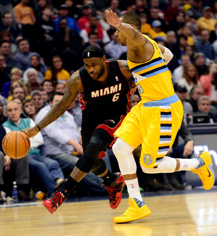. LeBron James (6) of the Miami Heat drives on Randy Foye (4) of the Denver Nuggets during the second half of Miami\'s 97-94 win.  (Photo by AAron Ontiveroz/The Denver Post)