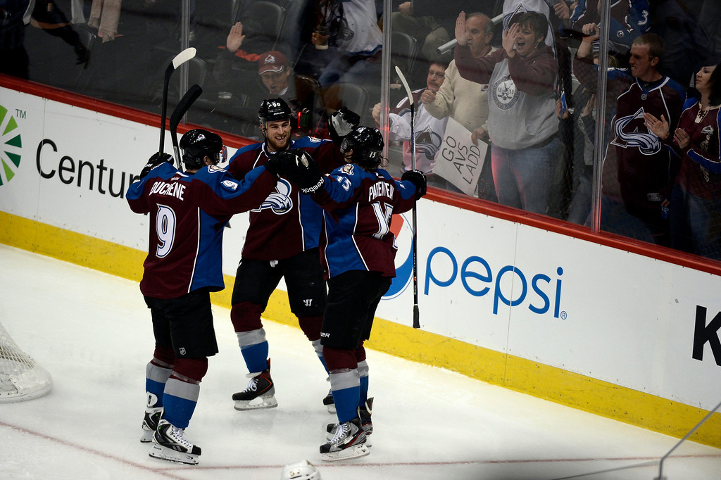 . Colorado Avalanche center Ryan O\'Reilly (90) celebrates his goal with Colorado Avalanche center Matt Duchene (9) and Colorado Avalanche right wing P.A. Parenteau (15) during the second period November 6, 2013 at Pepsi Center. (Photo by John Leyba/The Denver Post)