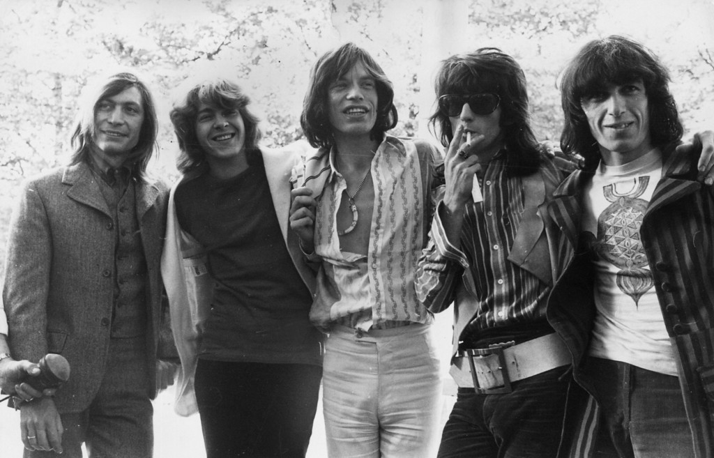 . 20-year-old Mick Taylor, former lead guitarist of the John Mayall rhythm and blues group replaces Brian Jones as the new member of the Rolling Stones. The group pose in Hyde Park, London - (from left to right) Charlie Watts, Mick Taylor, Mick Jagger, Keith Richards and Bill Wyman, June 13, 1969.  (Photo by J. Wilds/Keystone/Getty Images)