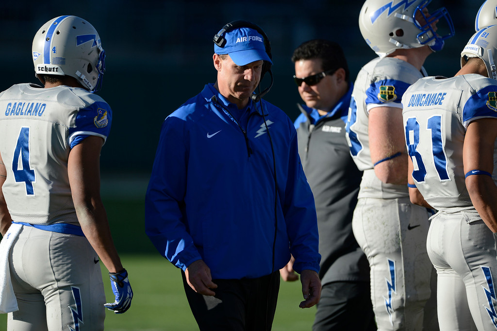 . Air Force head coach, Troy Calhoun, center, late in the game against the Colorado State Rams Saturday afternoon, November 30, 2013. Rams won 58-13. (Photo By Andy Cross/The Denver Post)