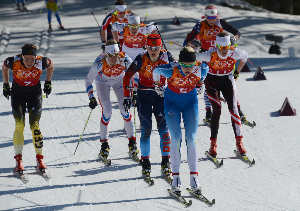 . (L-R) Germany\'s Nicole Fessel, France\'s Aurore Jean, Russia\'s Julia Ivanova, Finland\'s Anne Kylloenen and Austria\'s Katerina Smutna compete in the first leg of the Women\'s Cross-Country Skiing 4x5km Relay at the Laura Cross-Country Ski and Biathlon Center during the Sochi Winter Olympics on February 15, 2014, in Rosa Khutor, near Sochi. KIRILL KUDRYAVTSEV/AFP/Getty Images
