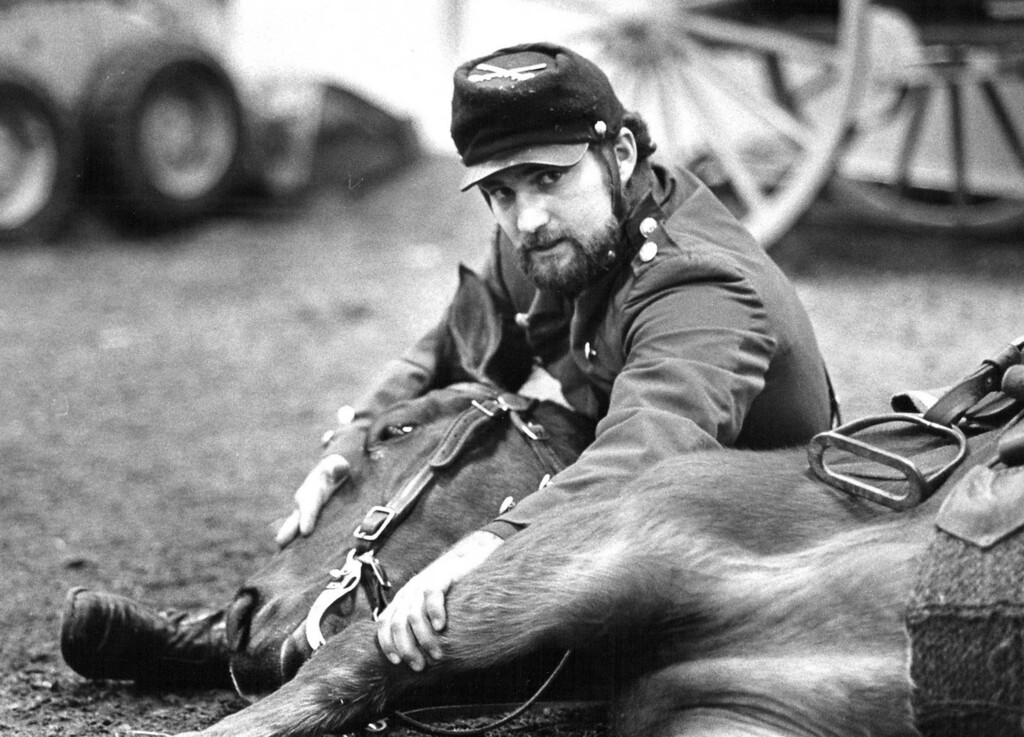 . Tad Griffith lays his Horse named Major down as part of his Union Army show at the National Western Stock Show. 1988. Dave Buresh, The Denver Post