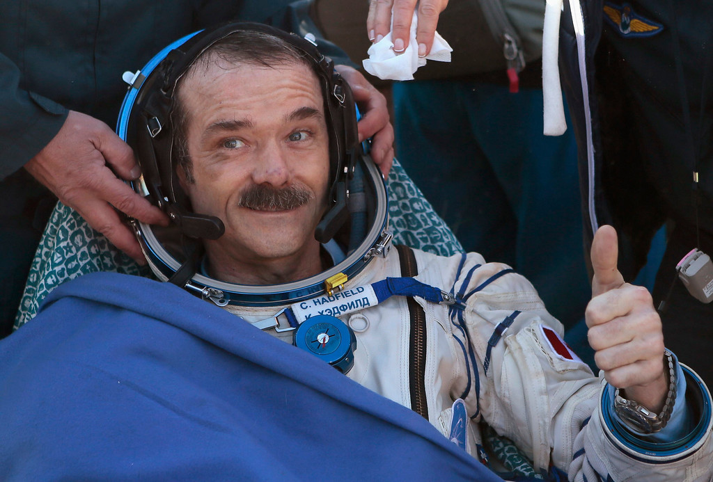 . Canadian astronaut Chris Hadfield gestures with a thumbs up after the Russian Soyuz space capsule landed some 150 km (90 miles) southeast of the town of Zhezkazgan, in central Kazakhstan May 14, 2013. REUTERS/Mikhail Metzel/Pool