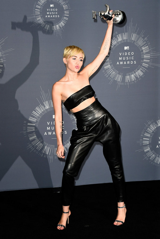 . Recording artist Miley Cyrus poses in the press room during the 2014 MTV Video Music Awards at The Forum on August 24, 2014 in Inglewood, California.  (Photo by Frazer Harrison/Getty Images)