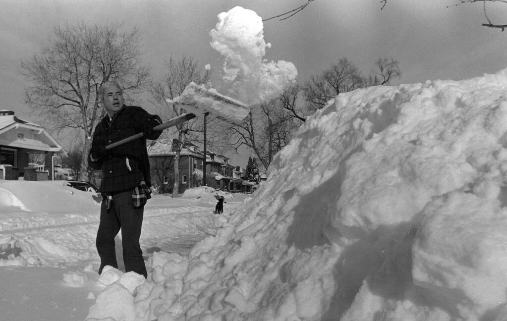 . Ed Morrell, 1360 Stteele, spent the majority of Christmas morning digging out two spots for the family cars along the street. The piles of snow he was leaving behind measured over 8 feet high. Denver Post Library Archive