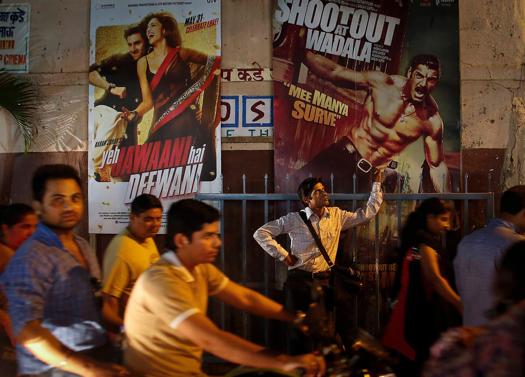". Ram Pratap Verma, a 32-year-old aspiring Bollywood film actor, waits outside a cinema after a film screening in Mumbai May 1, 2013. Bollywood is an addiction for many; an addiction that attracts thousands of aspiring stars to the city of Mumbai. Ram Pratap Verma made the journey from his small village eight years ago, and despite carrying his whole ""home\"" inside his bag, he is determined not to give up on his ambitions. He endeavours to watch at least one film a week at a cinema, where the silver screen keeps his dreams alive. Picture taken May 1, 2013. REUTERS/Danish Siddiqui"