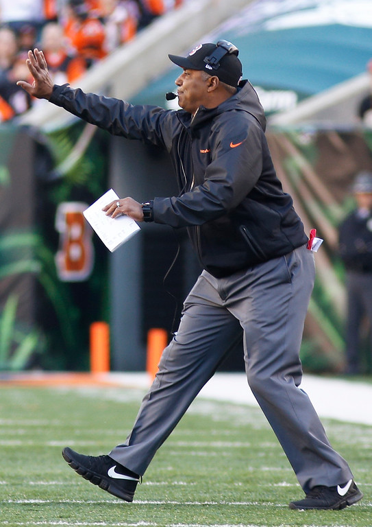 . Cincinnati Bengals head coach Marvin Lewis works on the sidelines in the first half of an NFL football game against the New York Jets, Sunday, Oct. 27, 2013, in Cincinnati. (AP Photo/David Kohl)