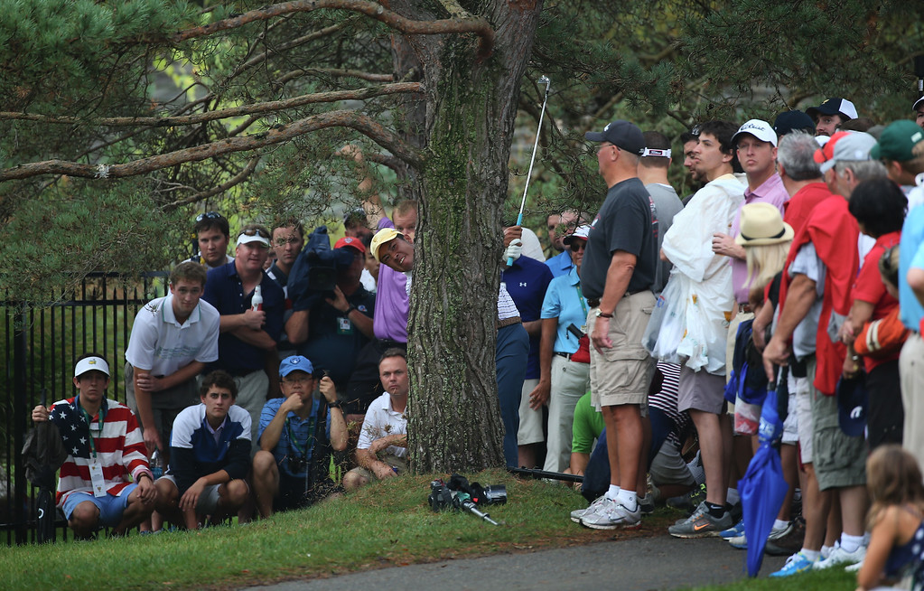 . DUBLIN, OH - OCTOBER 05:  Hideki Matsuyama of Japan and the International Team hits a shot from behind a tree on the tenth hole during the Day Three Four-ball Matches at the Muirfield Village Golf Club on October 5, 2013  in Dublin, Ohio.  (Photo by Andy Lyons/Getty Images)