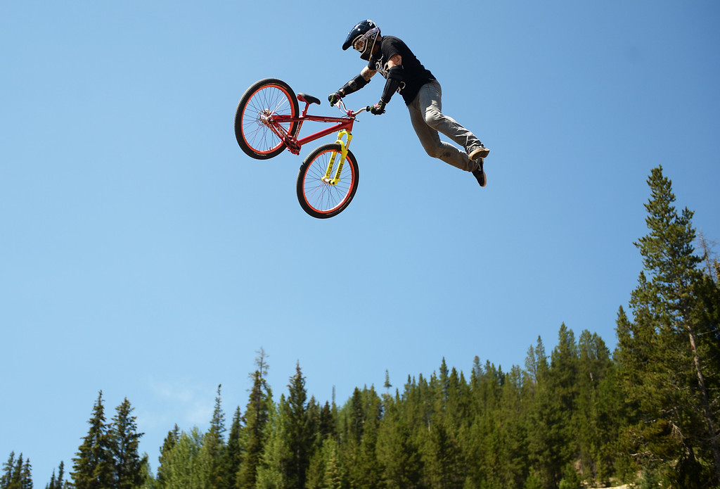 . WINTER PARK, CO. - July 26: Nick Coarke catches air during FMB Gold Slopestyle Open Training of First international Enduro World Cup Championship ever in U.S. at  Winter Park, Colorado. July 26, 2013. (Photo By Hyoung Chang/The Denver Post)