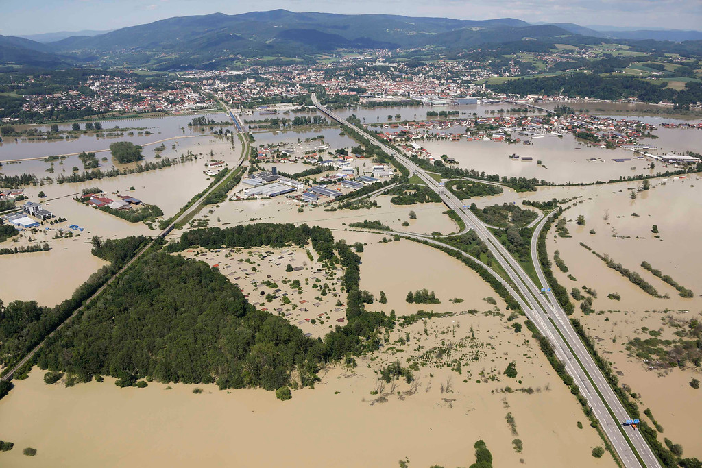 . The highway crossing of the A92 (bottom) and the A3 is flooded near the eastern Bavarian city of Deggendorf and the mountain rig of the Bavarian Forrest (rear) June 5, 2013, after one of Europe\'s most frequented highways was flooded by the nearby river Danube on June 4.  REUTERS/Wolfgang Rattay