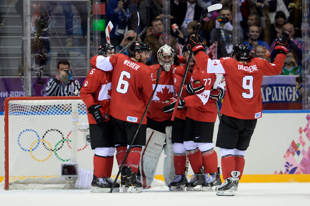 . Team Canada celebrates after the third period of Canada\'s 3-0 win in the men\'s ice hockey gold medal game against Sweden. Sochi 2014 Winter Olympics on Sunday, February 23, 2014 at Bolshoy Ice Arena. (Photo by AAron Ontiveroz/ The Denver Post)