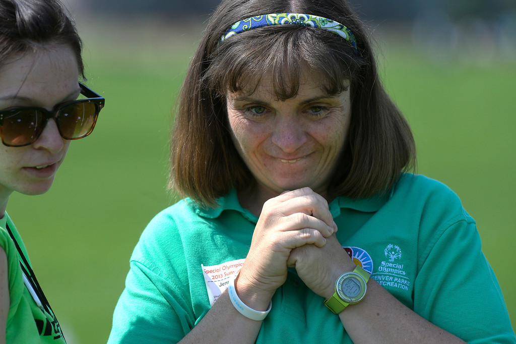 . DENVER, CO. - AUGUST 17: Jennifer Regan, right, waits for the final score during a game of bocce in the Special Olympics state championship at the Lowry Sports Complex in Denver, CO August 17, 2013. Special Olympics Colorado hosted its state championship in Bocce, Cycling, Golf, Softball and Tennis. Six hundred athletes competed in the events, which was supported by 250 volunteers and coaches. (Photo By Craig F. Walker / The Denver Post)