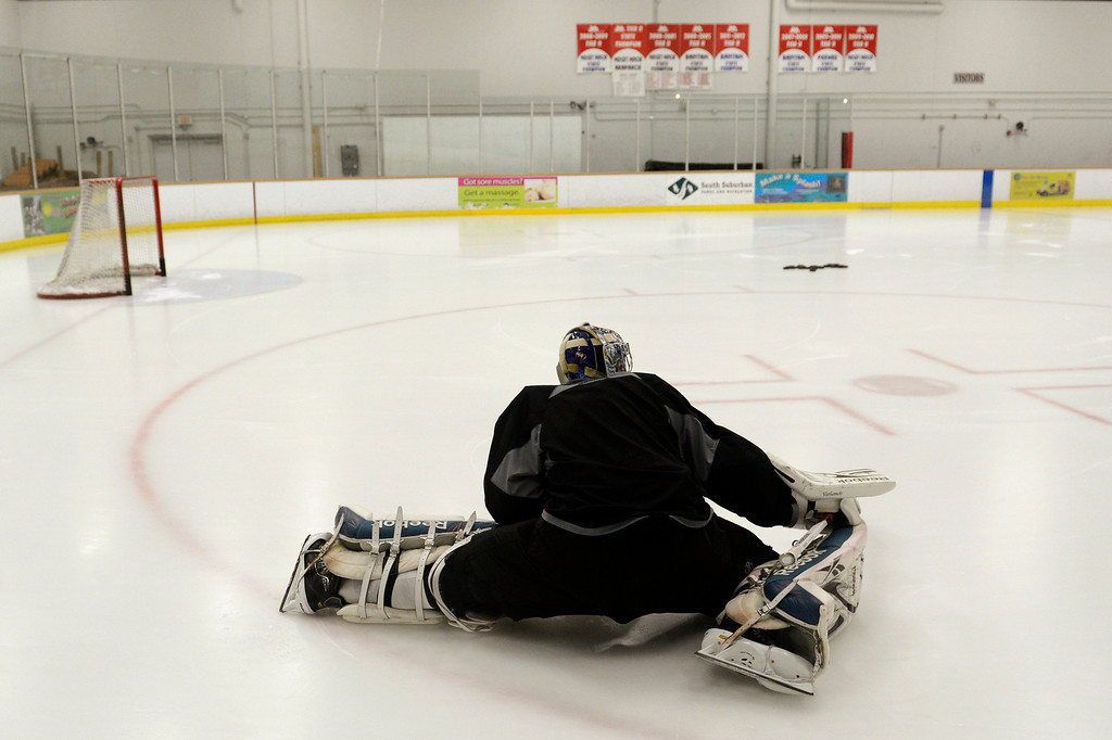 . Colorado Avalanche goalie Semyon Varlamov #1 stretches before training camp practice at Family Sports Center in Centennial, Colorado, Monday, January 14,  2013.    Joe Amon, The Denver Post