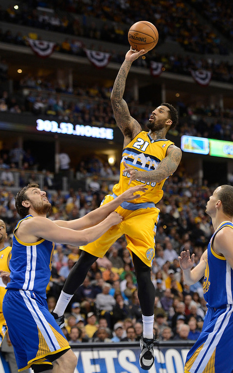 . DENVER, CO. - APRIL 20: Denver Nuggets shooting guard Wilson Chandler (21) puts up a shot over Golden State Warriors center Andrew Bogut (12) in the second quarter. The Denver Nuggets took on the Golden State Warriors in Game 1 of the Western Conference First Round Series at the Pepsi Center in Denver, Colo. on April 20, 2013. (Photo by John Leyba/The Denver Post)