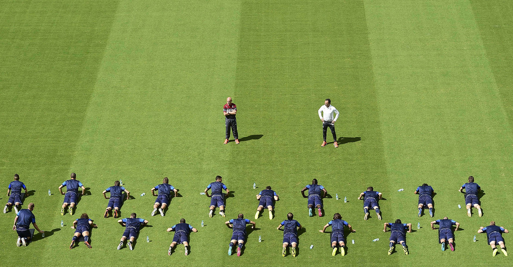 . Italy\'s squad warm up during a training session at the Pernambuco Arena in Recife, on June 19, 2014 on the eve of their 2014 FIFA World Cup group D football match against Costa Rica. RONALDO SCHEMIDT/AFP/Getty Images