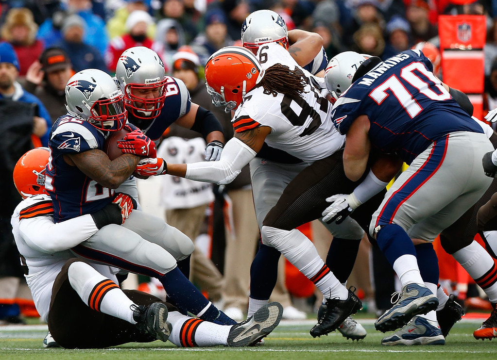 . Stevan Ridley #22 of the New England Patriots is stopped by the Cleveland Browns defense in the second quarter during the game at Gillette Stadium on December 8, 2013 in Foxboro, Massachusetts.  (Photo by Jared Wickerham/Getty Images)