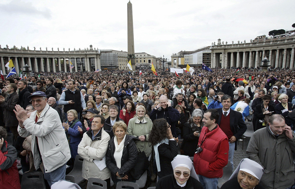 . People react as Germany\'s Joseph Ratzinger, the new Pope Benedict XVI,  appears at the window of St Peter\'s Basilica\'s main balcony after being elected the 265th pope of the Roman Catholic Church 19 April 2005 at the Vatican City.  PAOLO COCCO/AFP/Getty Images