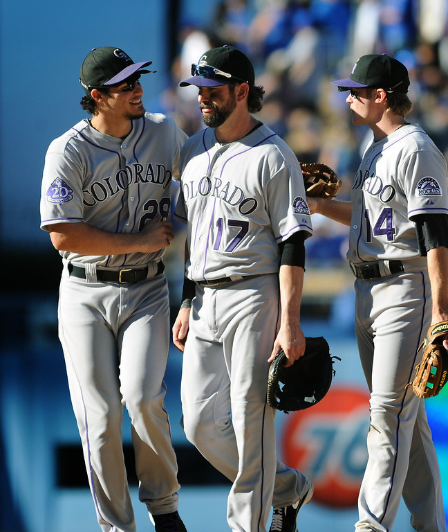 . Colorado Rockies\' Todd Helton, center, is congratulated by Nolan Arenado, left, and Jush Rutledge after they beat the Dodgers 2-1 Sunday, September 29, 2013, at Dodger Stadium. (Photo by Michael Owen Baker/L.A. Daily News)