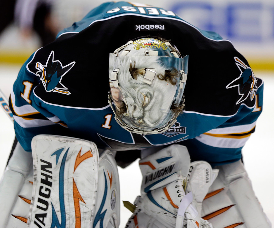 . San Jose Sharks goalie Thomas Greiss, of Germany, bends over during an NHL hockey game against the Colorado Avalanche in San Jose, Calif., Saturday, Jan. 26, 2013. (AP Photo/Marcio Jose Sanchez)