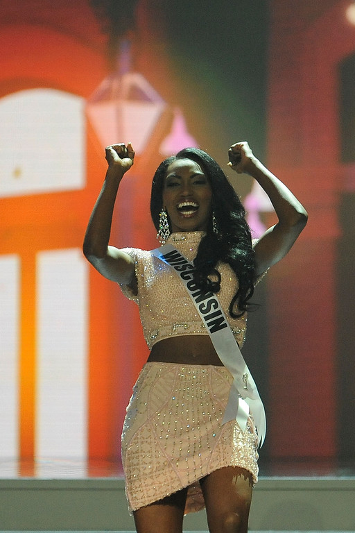 . Miss Wisconsin USA Bisharra Dorre reacts after advancing in the 2014 Miss USA Competition at The Baton Rouge River Center on June 8, 2014 in Baton Rouge, Louisiana.  (Photo by Stacy Revere/Getty Images)